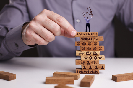 The concept of technology, the Internet and the network. Businessman shows a working model of business: Social media marketing Archivio Fotografico