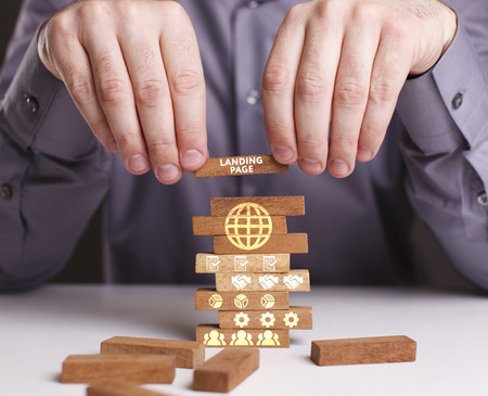 The concept of technology, the Internet and the network. Businessman shows a working model of business: Landing page