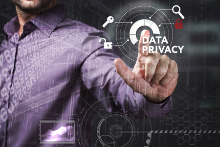 control fraud: Business, Technology, Internet and network concept. Young businessman working on a virtual screen of the future and sees the inscription: Data privacy Stock Photo