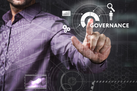 Business, Technology, Internet and network concept. Young businessman working on a virtual screen of the future and sees the inscription: Governance Standard-Bild