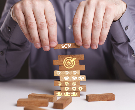 scm: The concept of technology, the Internet and the network. Businessman shows a working model of business: SCM
