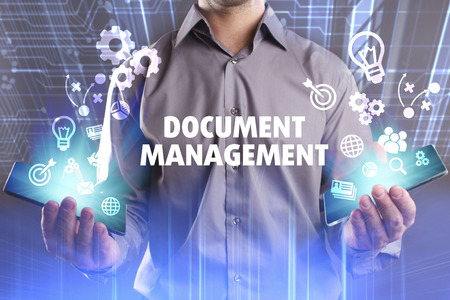 engine: Business, Technology, Internet and network concept. Young businessman working on a virtual screen of the future and sees the inscription: Document management Stock Photo