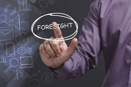 Business, Technology, Internet and network concept. Young businessman shows the word: Foresight