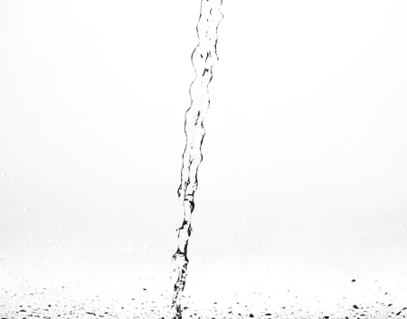coldly: Splashes of water on a white background. Water jet.