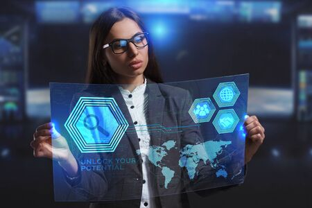 control fraud: The concept of business, technology, the Internet and the network. A young entrepreneur working on a virtual screen of the future and sees the inscription: Unlock your potential Stock Photo