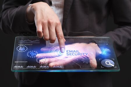 control fraud: The concept of business, technology, the Internet and the network. A young entrepreneur working on a virtual screen of the future and sees the inscription: Email security Stock Photo