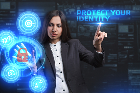 control fraud: The concept of business, technology, the Internet and the network. A young entrepreneur working on a virtual screen of the future and sees the inscription: Protect your identity