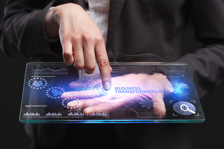 The concept of business, technology, the Internet and the network. A young entrepreneur working on a virtual screen of the future and sees the inscription: Business transformation Stock Photo - 79830516