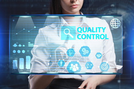 researching: The concept of business, technology, the Internet and the network. A young entrepreneur working on a virtual screen of the future and sees the inscription: Quality control