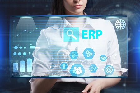 researching: The concept of business, technology, the Internet and the network. A young entrepreneur working on a virtual screen of the future and sees the inscription: ERP Stock Photo