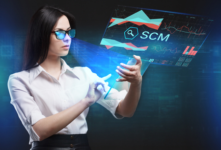 scm: The concept of business, technology, the Internet and the network. A young entrepreneur working on a virtual screen of the future and sees the inscription: SCM