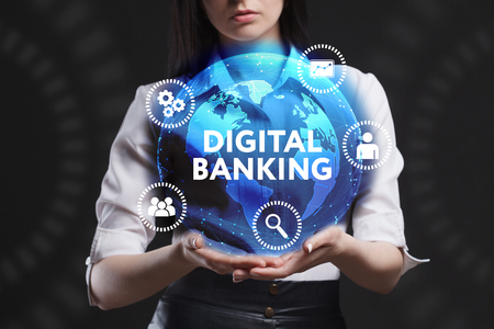 The concept of business, technology, the Internet and the network. A young entrepreneur working on a virtual screen of the future and sees the inscription: Digital banking