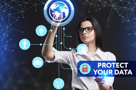protect: The concept of business, technology, the Internet and the network. A young entrepreneur working on a virtual screen of the future and sees the inscription: Protect your data Stock Photo