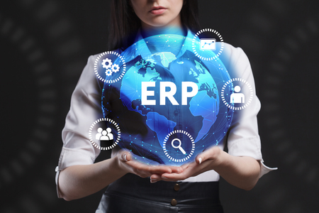 The concept of business, technology, the Internet and the network. A young entrepreneur working on a virtual screen of the future and sees the inscription: ERP Lizenzfreie Bilder