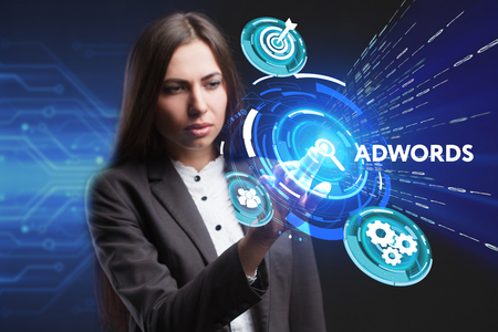 adwords: The concept of business, technology, the Internet and the network. A young entrepreneur working on a virtual screen of the future and sees the inscription: AdWords Stock Photo