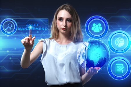 digital asset management: The concept of business, technology, the Internet and the network. A young entrepreneur working on a virtual screen of the future and sees the inscription: Asset management