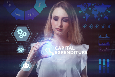 expenditure: The concept of business, technology, the Internet and the network. A young entrepreneur working on a virtual screen of the future and sees the inscription: Capital expenditure