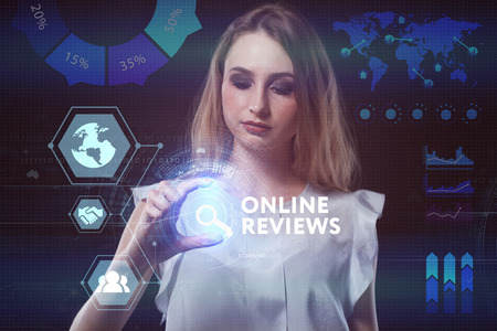 The concept of business, technology, the Internet and the network. A young entrepreneur working on a virtual screen of the future and sees the inscription: Online reviews Stock Photo