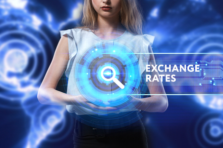 The concept of business, technology, the Internet and the network. A young entrepreneur working on a virtual screen of the future and sees the inscription: Exchange rates Stock Photo
