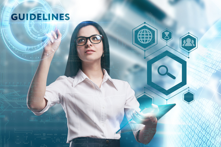keywords: The concept of business, technology, the Internet and the network. A young entrepreneur working on a virtual screen of the future and sees the inscription: Guidelines Stock Photo