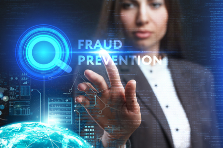 keywords: The concept of business, technology, the Internet and the network. A young entrepreneur working on a virtual screen of the future and sees the inscription: Fraud prevention Stock Photo