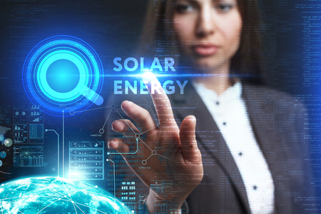 keywords: The concept of business, technology, the Internet and the network. A young entrepreneur working on a virtual screen of the future and sees the inscription: Solar energy