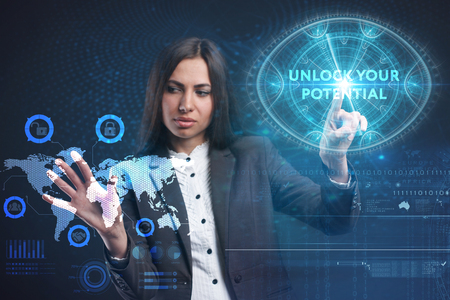 The concept of business, technology, the Internet and the network. A young entrepreneur working on a virtual screen of the future and sees the inscription: Unlock your potential Stock Photo