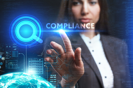 keywords: The concept of business, technology, the Internet and the network. A young entrepreneur working on a virtual screen of the future and sees the inscription: Compliance Stock Photo