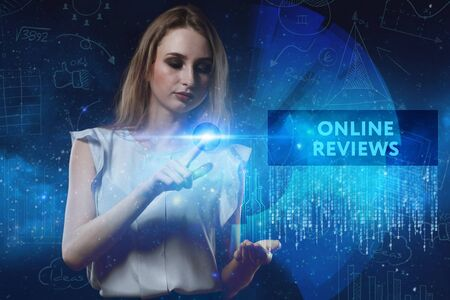 reviews: The concept of business, technology, the Internet and the network. A young entrepreneur working on a virtual screen of the future and sees the inscription: Online reviews Stock Photo