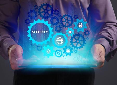 비즈니스, 기술, 인터넷 및 네트워크 개념. 젊은 사업가 미래의 가상 화면에서 작동 하 고 비문을 본다 : 보안 스톡 콘텐츠