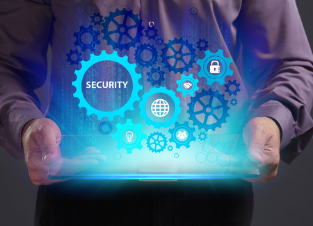 Business, Technology, Internet and network concept. Young businessman working on a virtual screen of the future and sees the inscription: Security Banque d'images