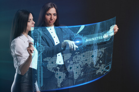 The concept of business, technology, the Internet and the network. A team of business women working on the virtual screen of the future and see the inscription: Mainstream Stock Photo