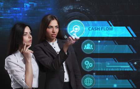 niche: The concept of business, technology, the Internet and the network. A young entrepreneur working on a virtual screen of the future and sees the inscription: Cash flow