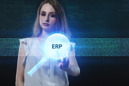 niche: The concept of business, technology, the Internet and the network. A young entrepreneur working on a virtual screen of the future and sees the inscription: ERP Stock Photo