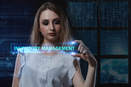 niche: The concept of business, technology, the Internet and the network. A young entrepreneur working on a virtual screen of the future and sees the inscription: Inventory management Stock Photo
