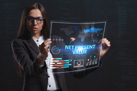 niche: The concept of business, technology, the Internet and the network. A young entrepreneur working on a virtual screen of the future and sees the inscription: Net present value Stock Photo