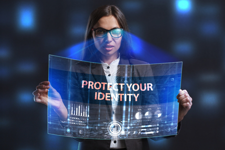 private security: The concept of business, technology, the Internet and the network. A young entrepreneur working on a virtual screen of the future and sees the inscription: Protect your identity