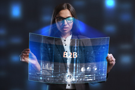 niche: The concept of business, technology, the Internet and the network. A young entrepreneur working on a virtual screen of the future and sees the inscription: B2B