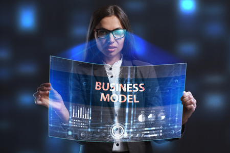 niche: The concept of business, technology, the Internet and the network. A young entrepreneur working on a virtual screen of the future and sees the inscription: Business model Stock Photo