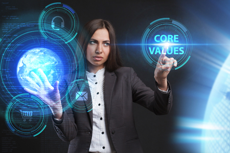questions: A young entrepreneur working on a virtual screen of the future and sees the inscription: Core values Stock Photo