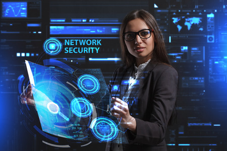 private security: A young entrepreneur working on a virtual screen of the future and sees the inscription: Network security Stock Photo
