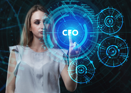 niche: The concept of business, technology, the Internet and the network. A young entrepreneur working on a virtual screen of the future and sees the inscription: CFO Stock Photo