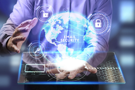 The concept of business, technology, the Internet and the network. A young entrepreneur working on a virtual screen of the future and sees the inscription: Email security Stock Photo