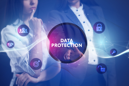 criminal: The concept of business, technology, the Internet and the network. A team of business women working on the virtual screen of the future and see the inscription: Data protection Stock Photo