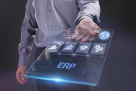 The concept of business, technology, the Internet and the network. A young entrepreneur working on a virtual screen of the future and sees the inscription: ERP Stock fotó
