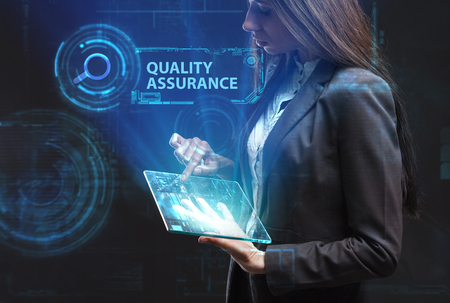 The concept of business, technology, the Internet and the network. A young entrepreneur working on a virtual screen of the future and sees the inscription: Quality assurance