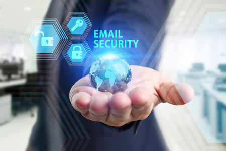 The concept of business, technology, the Internet and the network. A young entrepreneur working on a virtual screen of the future and sees the inscription: Email security Фото со стока