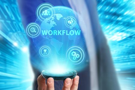 ビジネス、技術、インターネット、ネットワークのコンセプトです。未来の仮想画面に取り組んでいる青年実業家と碑文を見ている: ワークフロー 写真素材