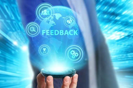 Business, Technology, Internet and network concept. Young businessman working on a virtual screen of the future and sees the inscription: Feedback