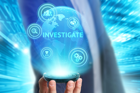 Business, Technology, Internet and network concept. Young businessman working on a virtual screen of the future and sees the inscription: Investigate Stock Photo
